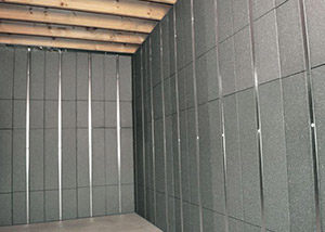 SilverGlo™ insulation and metal studs making up our Basement to Beautiful™ panels.  Installed in Somerville.